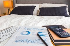 Graph chart report in bedroom, work at home. Stock Photos