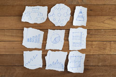 Graph chart on Ripped paper on Wood for idea Stock Photography