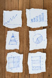 Graph chart on Ripped paper on Wood for plan Royalty Free Stock Images