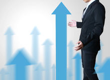 Graph chart showing his growth. Business man with a graph chart showing his growth Royalty Free Stock Photography