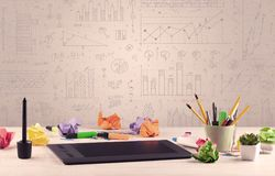 Graph charts and designer office desk Stock Images