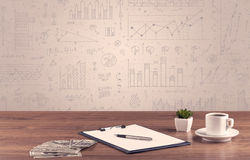 Graph charts and designer office desk Stock Photography