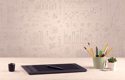 Graph charts and designer office desk Royalty Free Stock Photography