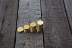 Graph from coins. Graph from money coins on wooden table Royalty Free Stock Images