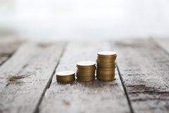 Graph from coins. Graph from money coins on wooden table Stock Images