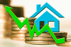 The graph of growth and a symbol of real estate on a background of money. The concept of changes in property prices Stock Image