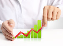 Graph in hand, businessmen Stock Photo