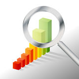 Graph and Magnifier Stock Photo