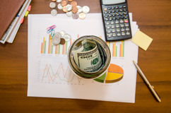 Graph with money, calculator and pen. Business concept - graph with money, calculator and pen Stock Image