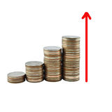 Graph and money growth concept in business. Coins on white background Royalty Free Stock Photography