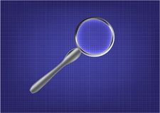 Magnifier on blue paper. Graph paper on a blue background and a magnifier Stock Images
