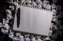 Graph paper notebook with pen Stock Photos
