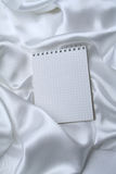 Graph paper on white silk Royalty Free Stock Images