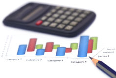 Graph with pencil and calculator. Over white background Stock Images