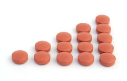 Graph of pills. Red pills or tablets, arranged to represent an ascending graph stock photo