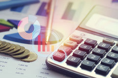Graph,row of money coins. Graph,row of money coisn and calculator on paper  finance, account and capital  banking concept Royalty Free Stock Photos