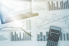 Graph sheets with pen and calculator Stock Photos
