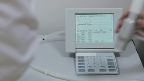 The graph in the spirometer device doctor is testing lung capacity tests stock footage