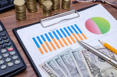 Graph with tablet pc and dollar Stock Images