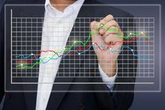 Graph on touchscreen. Businessman point the graph on touchscreen Royalty Free Stock Photography