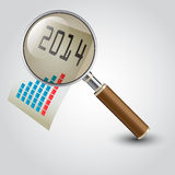 Graph under a magnifier Royalty Free Stock Image