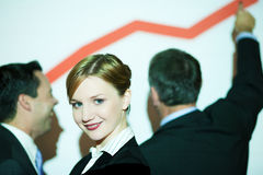 Graph on the wall with business team Stock Image