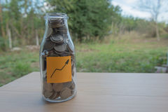 Graph Writing in the paper, Coins in a glass jar Stock Photos