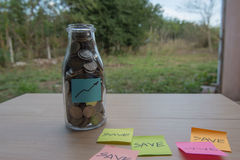 Graph Writing in the paper, Coins in a glass jar Stock Images