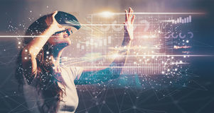 Graph with young woman with VR. Graph with young woman using a virtual reality headset Stock Photo