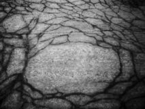 Graphic and abstract composition with cracks on the asphalt. royalty free stock photography