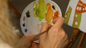 Graphic artist mixing oils color paints in palette stock video footage