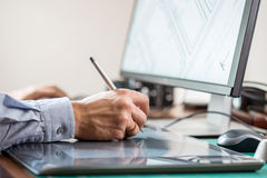Graphic artist using graphics tablet Royalty Free Stock Photography