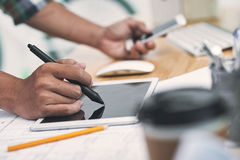 Graphic artist at work. Hand of graphic artist drawing on tablet stock photos