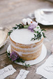 Graphic arts of beautiful wedding calligraphy cards and round cake with floral decorations. Royalty Free Stock Photo