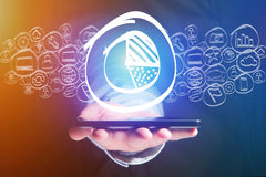 Graphic chart icon going out a smartphone interface - technology. View of a Graphic chart icon going out a smartphone interface - technology concept Stock Images