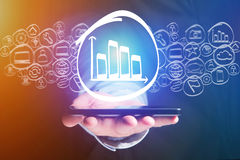 Graphic chart icon going out a smartphone interface - technology. View of a Graphic chart icon going out a smartphone interface - technology concept Royalty Free Stock Photo