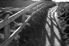 Graphic cliff edge fence path shadows Royalty Free Stock Photos