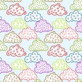 Graphic Clouds Seamless Pattern. Seamles tile with graphic clouds on a blue skie Royalty Free Stock Photos