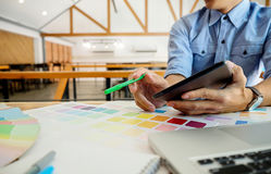 Graphic design and color swatches and pens on a desk. Architectu. Ral drawing with work tools and accessories Royalty Free Stock Photography