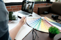 Graphic design and color swatches and pens on a desk. Architectural drawing with work tools and accessories. stock image