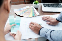 Graphic design and color swatches and pens on a desk. Architectural drawing with work tools and accessories. royalty free stock photography