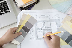 Graphic design and color swatches and pens on a desk. Architectural drawing with work tools and accessories. stock photos