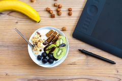 Graphic Design and Healthy Lifestyle Concept with Fruits. Graphic design and healthy lifestyle concept, top view of cup with raw bars and grape, kiwi fruits Stock Photo