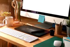 Graphic design studio workspace. Modern home office, mockup blank screen desktop computer on white workspace royalty free stock photos