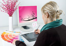 Graphic designer. Draws computer illustrations stock photos