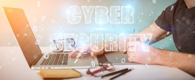 Graphic designer using cyber security text hologram 3D rendering. Graphic designer on blurred background using cyber security text hologram 3D rendering Royalty Free Stock Photo