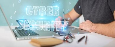 Graphic designer using cyber security text hologram 3D rendering. Graphic designer on blurred background using cyber security text hologram 3D rendering Stock Photo