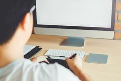 Graphic designer Brainstorming drawing on graphics tablet at workplace.  stock photos