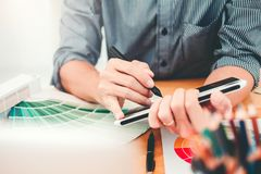 Graphic designer Brainstorming drawing on graphics tablet at workplace.  stock photography