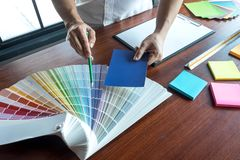 Graphic designer choose colors from the color bands samples for design .Designer graphic creativity working concept royalty free stock photography